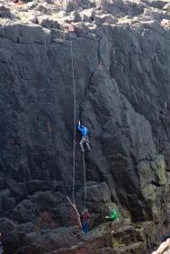 Pete climbing at Breigeo, Papa Stour
